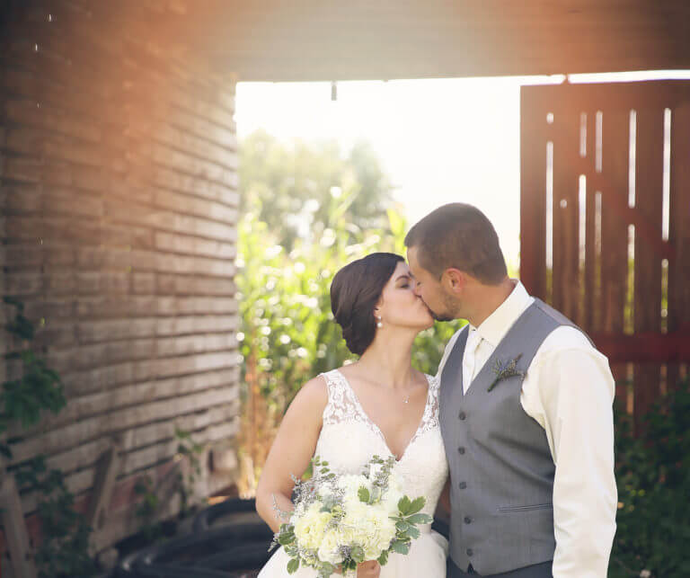 Couple photo inside rustic weathered grain bin